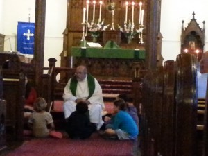 Father Tom delivering the Children's Sermon